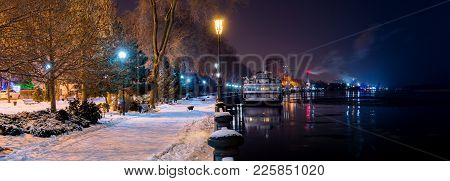 Night View From The Embankment Of Rostov-on-don On River Don To The East. River Cruise Ship In Winte