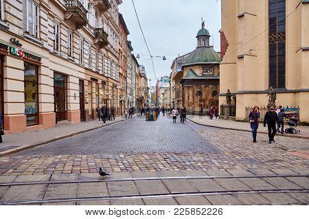 Lviv, Ukraine - November, 2017. Central Pedestrian Street Of Lviv. Many Tourists Walk Around The Old