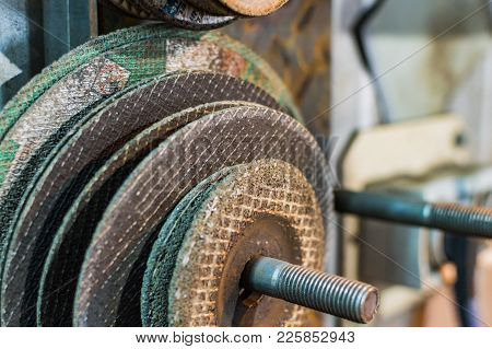 News And Used Angle Grinder Discs Different Sizes. Selective Focus.