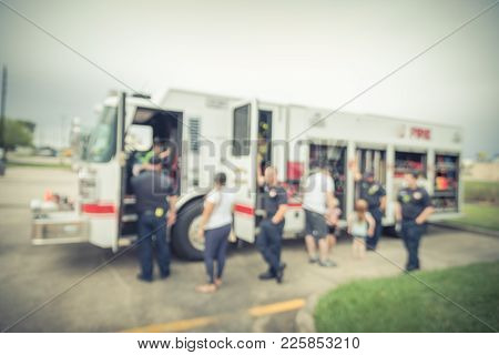 Blurred Fire Truck Visits Promote Community Safety In Usa