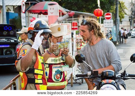 Phuket, Thailand - February, 03, 2017: Road Service Employee Or Traffic Controller Helps Motorcyclis