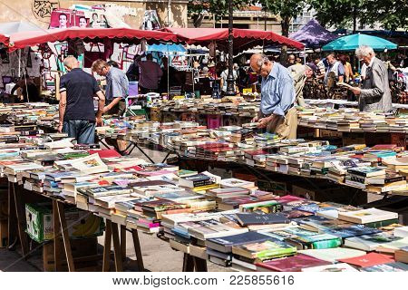 People Choosing Used Books At The Flea Aligre Market. Paris, France