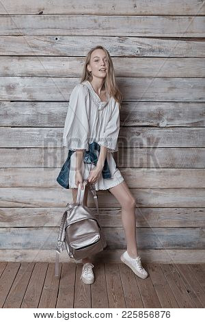 Smiling Girl Wearing Natural Makeup, Linen Dress And Boots. Concept Of Purity, Youth, Beautiful Skin