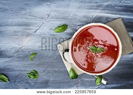 Hot Tomato Soup With Basil Leaves. Image Shot From Above In Flat Lay Style.
