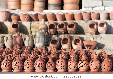 Rustic Handmade Ceramic Clay Brown Terracotta Pots At Street Handicraft Market. Turkish Mass Product