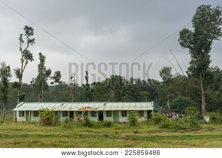 Coorg, India - October 29, 2013: Dubare Elephant Camp. Green, Public-housing, Long-house With Metal