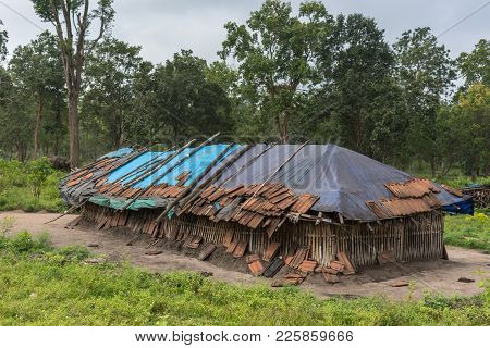 Coorg, India - October 29, 2013: Dubare Elephant Camp. Family Dwelling Is Long Bamboo-clay Hut With