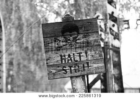 Warning Sign On The Barbed Wire In A Concentration Camp In Auschwitz (poland)