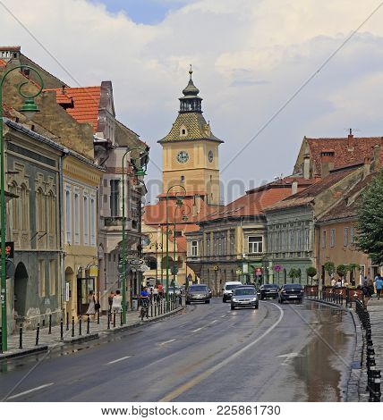 Brasov, Romania - July 25, 2017: People Are Walking By The Street In Old Town Of Brasov, Romania