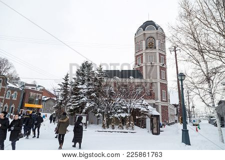 Otaru, Japan, January 28, 2018: The Le Tao Clock Tower With Chiming Bells Is The Home Of Le Tao, The