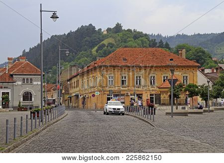 Brasov, Romania - July 25, 2017: People Are Walking By Union Square In Brasov, Romania