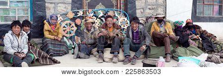 Ngari, China - May 4, 2013: Tibetan Men Working In Buddhist Temple In Ngari Prefecture