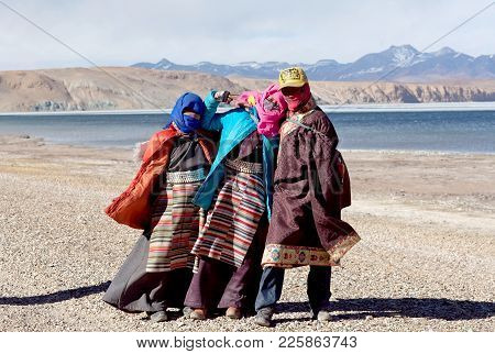 Ngari Prefecture, Tibet - May 7, 2013: Tibetan Pilgrims In National Clothes Walking On The Road Arou