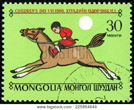 Ukraine - Circa 2018: A Postage Stamp Printed In Mongolia Show The Child Is Riding A Horse. Series: