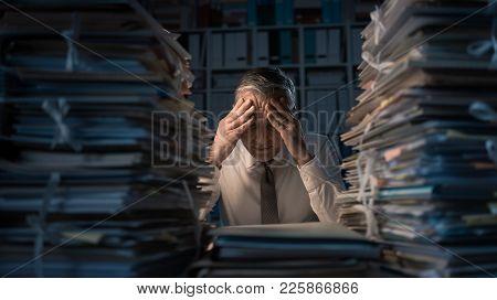 Desperate Businessman Working Late