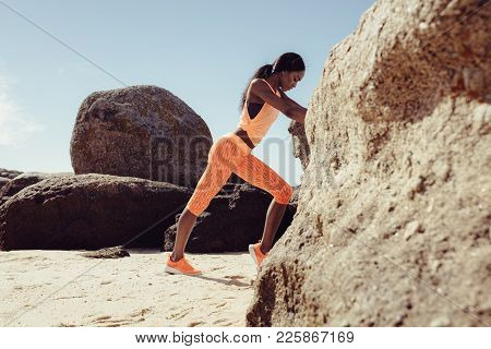 African Woman Resting At Beach After Her Workout