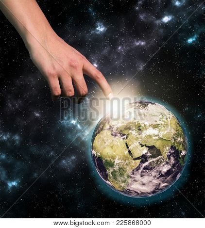 Female hand reaching out to the globe in space, collage. Elements of this image furnished by NASA
