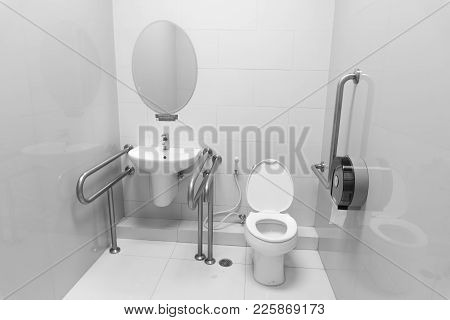 Inside Disable Toilet , Black And White Background. Disable Concept.