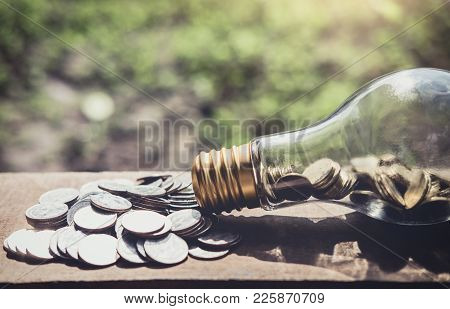 Stacking Coins And Money Growing For Saving, Coin In Glass Bottle With Money Stack For Business Plan