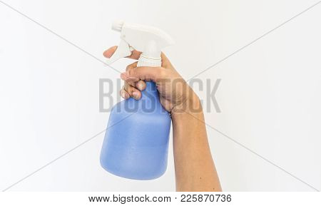 Spraying A Cloth With Laundry Detergent In Spray Bottle On Hand.