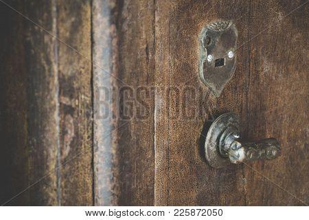 Close Up Of Old Vintage Copper Rusty Keyhold Safe Lock On Metal Door Safe. Old Door Metal Keyhold Wi