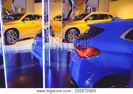 Fashionable Bright Auto Show A Number Of New Cars Parked In The Car Dealers' Warehouse, Modern Desig