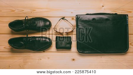 Set Of Male Items: Black Leather Shoes, Black Leather Wallet, Sunglasses And Black Leather Briefcase