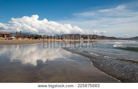 Cumulus Cloud Reflected At Cerritos Beach In Baja California In Mexico Bcs