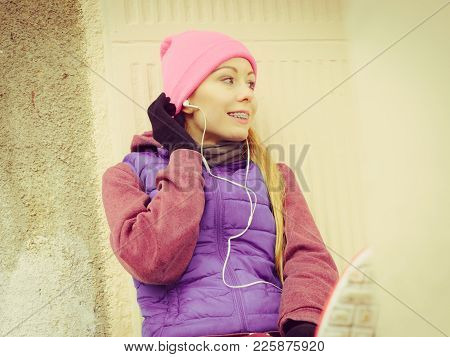 Outdoor Sport Exercises, Sporty Outfit Ideas. Woman Wearing Warm Sportswear Relaxing After Exercisin