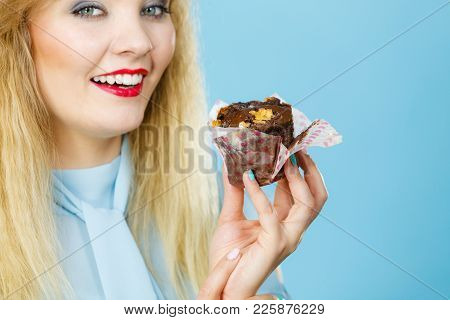 Sweet Food Sugar Make Us Happy. Attractive Blonde Woman Holds Yummy Chocolate Cupcake In Hand, Cravi