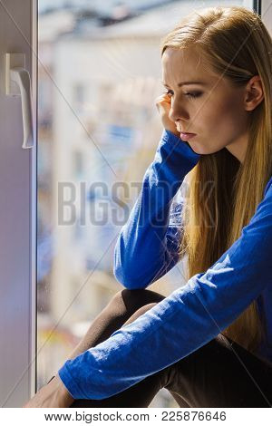 People And Solitude Concept. Alone Sad Young Woman Long Hair Teen Girl Sitting On Window Sill Lost I