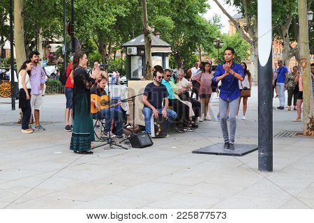 Seville, Spain - May 21, 2017: Unidentified Street Artists Dance Flamenco On The Street In The Eveni
