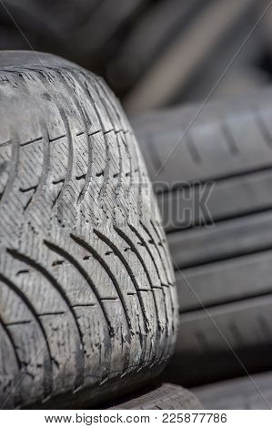 Pile Of Used Rubber Tyres In A Garage Back Yard.