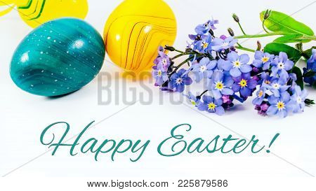 Easter Eggs And Forget-me-not Spring Flowers On White Background With Copy Space. Border Template, E