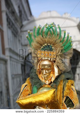 Venice, Italy - February 5, 2018: Person In Costume With Golden Mask
