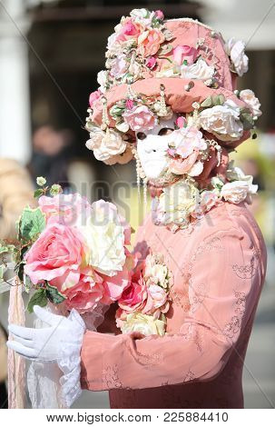 Venice, Italy - February 5, 2018: Person In Costume With Pink Carnival Mask