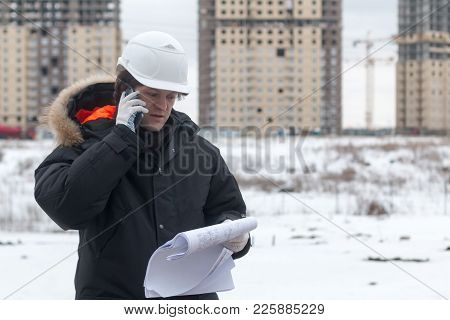 Architect, Engineer, Project Manager Or Senior Engineer Man Talking On Cb Phone To Building In The C