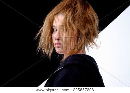 Girl With Shaggy Hair. Girl With Shaggy Hair On Black And White Background. Young Girl Filmed Half-t