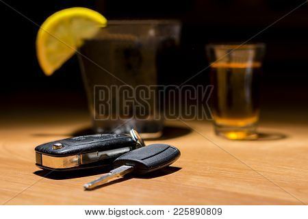 Car Keys Laid On The Bar Beside Cocktail And Whiskey