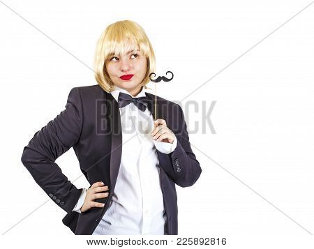 Elegant Woman In A Tailcoat With A Black Paper Mustache On A Stick On A White Background