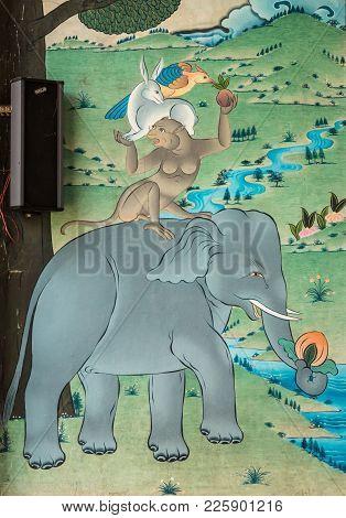 Coorg, India - October 29, 2013: Outside Wall Painting Under Mandapam  Padmasambhava Vihara At Namdr
