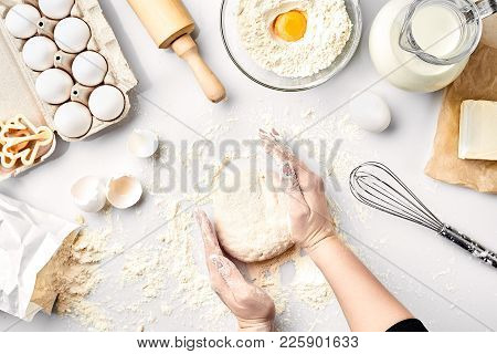 Baker Preparing To Knead The Dough, Top View. Cooking, Bakery Concept. Still Life. Flat Lay. White B