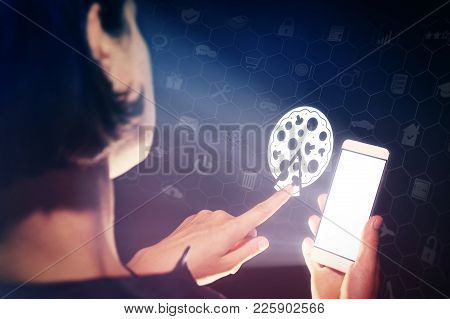 Image Of A Girl With A Smartphone In Her Hands. She Presses On The Pizza Icon. Search And Online Ord