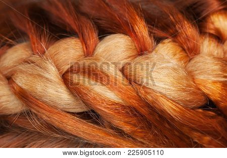 Beautiful, Healthy, Long, Curly, Red Hair Close-up. Braiding. Professional Hair Care.