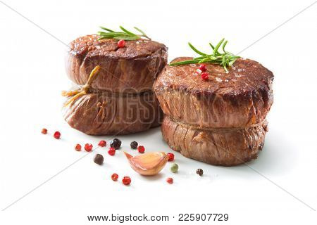 Grilled beef fillet steaks mignon with spices isolated on white background