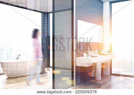 Gray Hexagon Tile Bathroom Interior With A Double Sink Standing On A Wooden Shelf And A White Bathtu