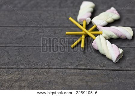 Marshmallow On A Wooden Stick On Wood Background. A Sweet, Soft, Chewy Raw Marshmallow On A Stick