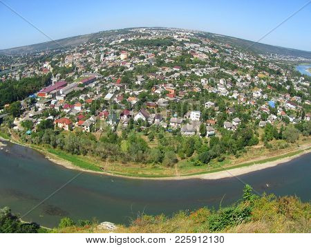 Top Picturesque View Of Spring Dnister River Bend Canyon And Famous Ukrainian Zalischyky Town.  Pano