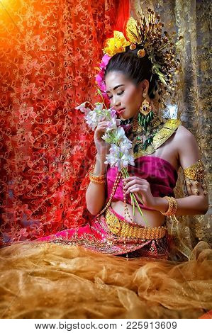 Thai Woman Classical Dancer On Black Background, Woman Wearing Laos Traditional Dress Costume,vintag