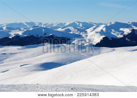 Panoramic View Of The Snowy Peaks Romanian Carpathians From Ski Slopes Of The Resort Sinaia, Romania